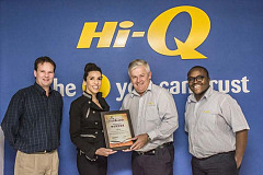 From left - Jaco vd Merwe the owner of Hi-Q Croydon, Maria Petousis Director of TGI handing over the award to Sean Harrison MD Hi-Q Automotive and Dominic Mphasa Hi-Q Retail Marketing Co-ordinator