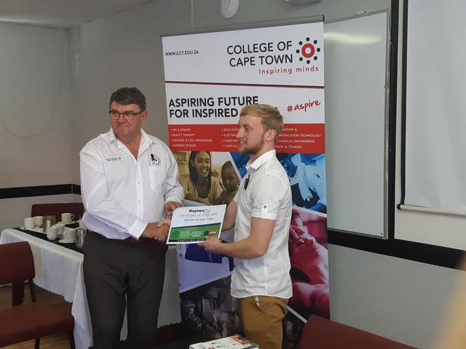 Donovan Harwick, HaynesPro, (right) presents the HaynesPro donation to Louis van Niekerk, Principal College of Cape Town (left).