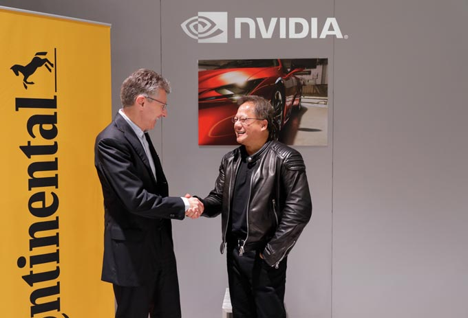 Continental CEO Dr. Elmar Degenhart (left) and NVIDIA founder and CEO Jensen Huang (right) are partnering together to create Artificial Intelligence for self-driving vehicle.