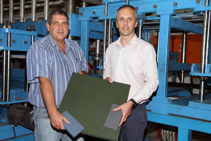 Aldo Steyn and Mehran Zarrebini pictured with one of the machines in the Durban factory that manufacture MasterFibre moulded rubber products.