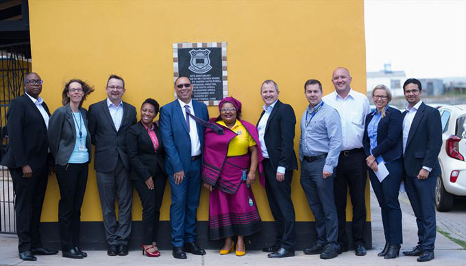 The Goodyear South Africa and Sub-Saran African leadership team standing with Mrs Zoliswa Njiyela, Stephen Nkomo Primary School Principal, and Mr Isaac Bali from the Department of Education.