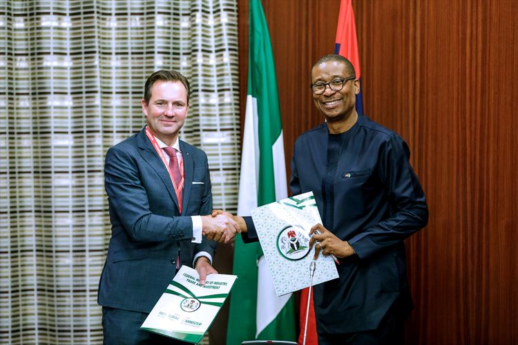 Thomas Schaefer, Head of Volkswagen Sub-Saharan Region and Managing Director: Volkswagen Group South Africa and Dr. Okey Enelamah, Nigeria's Minister of Industry, Trade and Investment shake hands after the signing of the Memorandum of Understanding (MoU) to develop an automotive hub in Nigeria.