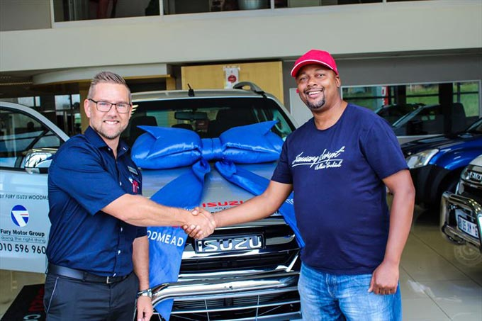 Wesley van Zyl, Sales Executive of Fury Isuzu Woodmead, hands over the keys to Pfarelo Mphaphuli