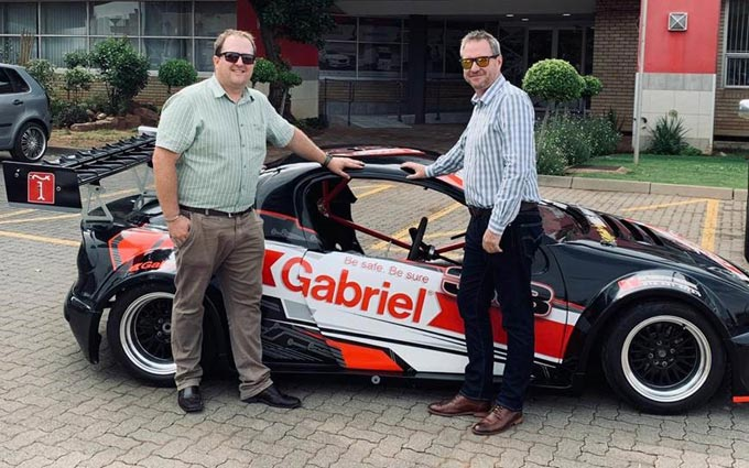 Richard Berner(left) and Greame Futter, Gabriel marketing executive next to the Tigra Space Frame 13B Rotary Turbo Saloon Sponsored by Gabriel Shock Absorbers