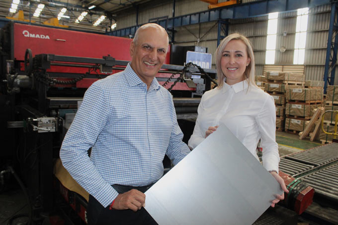 Allied Steelrode General Manager: Sales – Automotive, Lee-Ann Geyser (right) and Allied Steelrode CEO, Arun Chadha inspect one of the company's precision cut-to-size products.