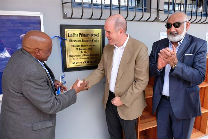 (Unveiling of plaque)  - Mr Lawrence Ngcobo (left), principal of Lindisa Primary School, receives the new library and resource centre from Mr Niall Lynch, CEO of Hyundai Automotive SA. On the right is Mr Osman Arbee, CEO of Motus Holdings.