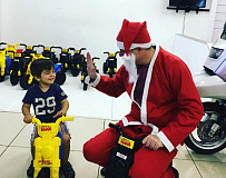 The FIRE IT UP's Father Craig Christmas was on hand to deliver the gifts to the kids