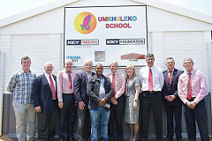 The Isuzu Key team and strategic partners celebrate the opening of the seventh super project in Kwa-Zulu Natal.  From left are Stewart Walker, Craig Uren, Tony Dos Reis, Colin Cowie, Prince Xolani Zondi, Paul Emanuel, Hilary Smith, Michael Sacke, Mike Hall-Jones and Dale Southern.