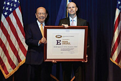 "Eric Snyder (right), SEMA's congressional affairs director, received the ""E"" Star Award from U.S. Department of Commerce Secretary Wilbur Ross."