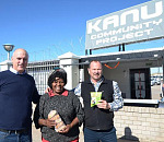 Pumla Mtini was all smiles when she took ownership of her new shop handed to her by Kanu Managing Director, Mike Pienaar, left, and Kanu General Manager: Manufacturing and Engineering, Wynand Moller